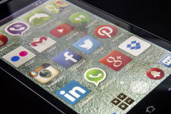 Popular social media icons on smart phone screen Stock Image
