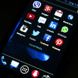 Popular social media icons on smart phone screen Royalty Free Stock Photo