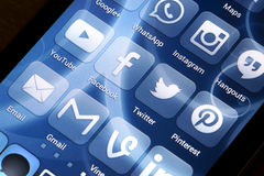 Popular social media icons on smart phone screen Royalty Free Stock Images