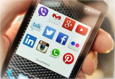 Popular social media icons on smart phone screen Stock Photos