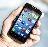 Popular Social media icons on smart phone screen Stock Photo