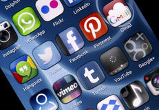 Popular social media icons Twitter, Facebook and other on smart phone screen Stock Photo