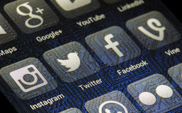 Popular social media icons Twitter, Facebook and other on smart phone screen Stock Image