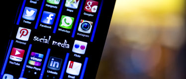 Popular social media icons Twitter, Facebook and other on smart phone screen close up Royalty Free Stock Photography