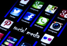 Popular social media icons Twitter, Facebook and other on smart phone screen close up Stock Photos