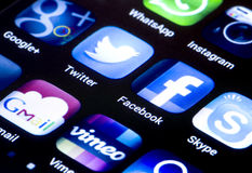 Popular social media icons twitter facebook and other on smart phone screen close up Stock Photos