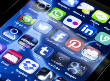 Popular social media icons Twitter, Facebook and other on smart phone screen close up Royalty Free Stock Photo