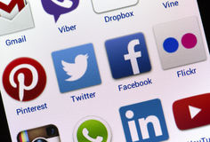 Popular social media icons Twitter, Facebook and others on smart phone screen stock photo