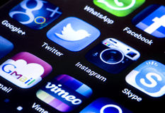 Popular social media icons twitter, instagram and other on smart phone screen Stock Photos