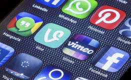 Popular social media icons vimeo vine and other on smart phone screen close up Royalty Free Stock Photo