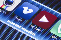 Popular social media icons vimeo youtube and other on smart phone screen close up Stock Image