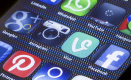 Popular social media icons vine instagram and other on smart phone screen close up Royalty Free Stock Photography