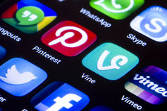 Popular social media icons vine pinterest and other on smart phone screen close up Stock Photos