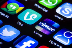 Popular social media icons vine vimeo  and other on smart phone screen close up Royalty Free Stock Photography