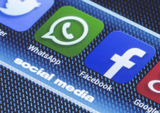 Popular social media icons whatsapp facebook and other on smart phone screen close up Royalty Free Stock Photography
