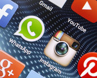 Popular social media icons Whatsapp, Instagram and other on smart phone screen close up Stock Photo