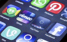 Popular social media icons youtube vimeo and other on smart phone screen close up Stock Photos