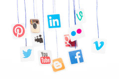 Popular social media website logos printed on paper and hanging Royalty Free Stock Images