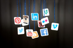 Popular social media website logos printed on paper and hanging Royalty Free Stock Photography