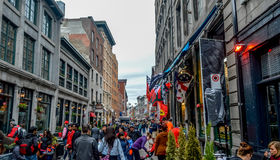 Popular St Paul street in the Old Port. People can be seen around. Stock Images