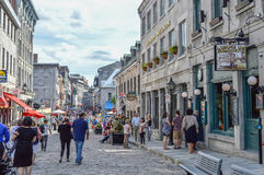 Popular St Paul street in the Old Port. People can be seen around. Royalty Free Stock Images