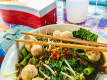 Popular street food in Thailand (Kuai Tiao Moo Namtok) that cons. Isted of pork ball, pork meat, basil or thyme, bean sprouts, morning glory, noodle and creamy Stock Photo