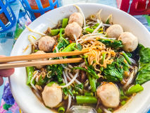 Popular street food in Thailand (Kuai Tiao Moo Namtok) that cons. Isted of pork ball, pork meat, basil or thyme, bean sprouts, morning glory, noodle and creamy Stock Photography