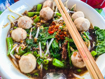 Popular street food in Thailand (Kuai Tiao Moo Namtok) that cons. Isted of pork ball, pork meat, basil or thyme, bean sprouts, morning glory, noodle and creamy Royalty Free Stock Photography