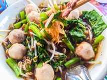 Popular street food in Thailand (Kuai Tiao Moo Namtok) that cons. Isted of pork ball, pork meat, basil or thyme, bean sprouts, morning glory, noodle and creamy Royalty Free Stock Photos