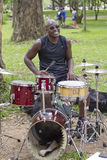 Popular street musician singing in the public park Stock Images