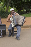 Popular street musician singing in the public park Royalty Free Stock Photography