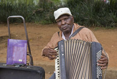 Popular street musician singing in the public park Royalty Free Stock Images