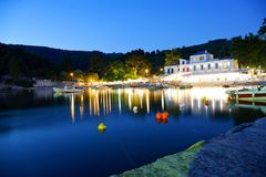 Agnontas beach and bay at sunset, Skopelos, Greece. Popular summer holiday place with greek tavernas and small harbour royalty free stock photos
