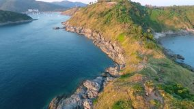 Popular sunset viewpoint Promthep Cape aerial shot with tourists. HD slowmotion quadcopter take off. Phuket, Thailand. stock video