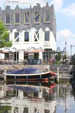 People at a castle terrace along the river, Amersfoort, Netherlands  Royalty Free Stock Photography