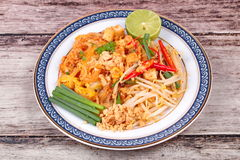 Popular Thai fried noodle call Pad Tai on Thai-pattern dish. Royalty Free Stock Photos