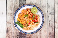 Popular Thai fried noodle call Pad Tai on Thai-pattern dish. Royalty Free Stock Photography