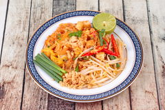 Popular Thai fried noodle call Pad Tai on Thai-pattern dish. Stock Photos