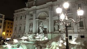 Popular tourist attraction in Rome - the famous Fountains of Trevi by night stock video footage