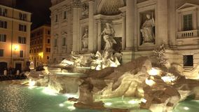 Popular tourist attraction in Rome - the famous Fountains of Trevi by night stock footage