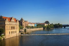 Panoramic view of Prague on a sunny day. Popular tourist destination in Prague. Beautiful panoramic view of historical buildings and river in Prague on a sunny Stock Photo