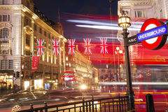 Popular tourist Picadilly circus with flags union jack in night Royalty Free Stock Image