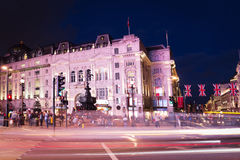 Popular tourist Picadilly circus with flags union jack in night Royalty Free Stock Images