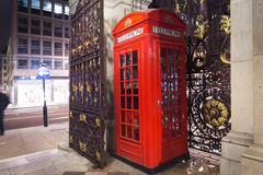 Popular tourist Red phone booth in night lights illumination in. United Kingdom, England, London - 2016 June 17: Popular tourist Red phone booth in night lights Royalty Free Stock Photo