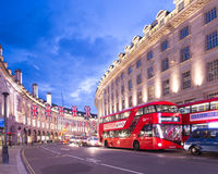 Popular tourist Regent street with flags union jack at night Royalty Free Stock Photo