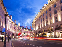 Popular tourist Regent street with flags union jack at night Stock Image