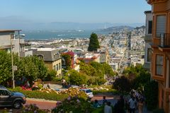 Popular touristic landmark Lombard street at sunny day time. San Francisco, USA - September 10, 2018: Popular touristic landmark Lombard street at sunny day time royalty free stock image