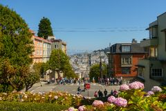 Popular touristic landmark Lombard street at sunny day time. San Francisco, USA - September 10, 2018: Popular touristic landmark Lombard street at sunny day time stock photo