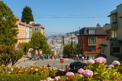 Popular touristic landmark Lombard street at sunny day time. San Francisco, USA - September 10, 2018: Popular touristic landmark Lombard street at sunny day time stock image