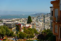 Popular touristic landmark Lombard street at sunny day time. San Francisco, USA - September 10, 2018: Popular touristic landmark Lombard street at sunny day time royalty free stock photo